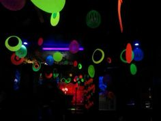 Black light party. I spent 4.50 in neon poster board and 2.50 for fishing line. 9.00 online for the animal glow baloons. And 1.00 each for white crate paper and neon pipe cleaners. This party was super cheap and looks amazing under black light!