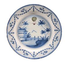 A London delft blue, green and manganese commemorative plate for the balloon ascent of Vincenzo Lunardi , circa 1785, the ballon depicted ascending above buildings and trees and with a 'V' formation of birds beneath , withina swag border, 35cm diameter Cf. Michael Archer, Delftware ( V. & A. Museum 1997), p. 124 for two examples of similar plates in the collection of the Victoria and Albert Museum, South Kensington.