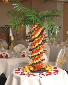 Pineapple tree fruit kabob centerpiece.