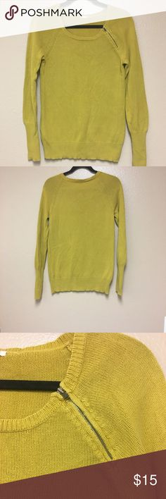Mustard J Crew Sweater The 100% cotton J Cree sweater is in a size small, it is very comfortable and the color is very unique. I really like the zipper at the top right corner, gives it more detail than just a basic sweater. J. Crew Sweaters
