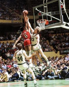Even at Julius Erving had crazy hops. In this 1982 photo, Dr. J dunks over Larry Bird and (an unpictured) Kevin McHale during the Game 7 of the Eastern Conference Championship. Philadelphia went onto win the game but lost to the Lakers in the NBA Finals. Sport Basketball, Basketball Pictures, Basketball Legends, Basketball Players, Basketball Jones, Basketball Stuff, Jordan Basketball, Basketball History, Basketball Shirts