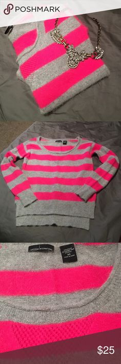 Moda International Slouchy Sweater Super soft and warm slouchy sweater. Can be worn off one shoulder or slouched done over both. Pink and grey colors. Size is extra small but can also fit a small. Sweater is stretchy. I recommend layering a tank underneath. No flaws in garment. Perfect fall/winter staple. Comes from a smoke free home. Moda International Sweaters Crew & Scoop Necks