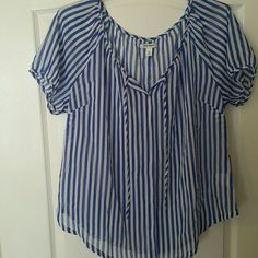Cute top Blue & white striped sheer blouse. It ties at neckline. A cami or tank should be worn underneath. 100% Polyester. Never worn Old Navy Tops Blouses