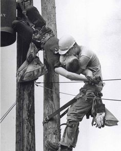 """tedbunny:  """"The Kiss of Life"""". This iconic photo shows a utility worker receiving mouth-to-mouth after being electrocuted. He survived. (1967)."""