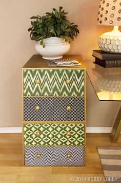 Turn a past-its-prime file cabinet (or two stacked organizer cubes) into a home office success story with nothing more then patterned paper. Remove the knobs first, then adhere paper to the drawer fronts and re-install the knobs.
