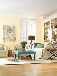 Normally not a fan of yellow. I like the combination of light browns & blues, but I actually like the look of this yellow wall with the hits of blue and natural browns. (Pittsburgh Paints Turning Oakleaf yellow) Living Room - You can also add punches of other, bolder colors, such as the peacock blue on the table and pillows here. Because Turning Oakleaf is fairly light and muted, it can work as a neutral background hue to pretty much any other color.
