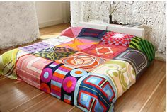 love the pop of colour - quilt from vintage scarves