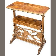 A French Art Nouveau two-tiered marquetry parlant table: Travail est Joie  circa 1900