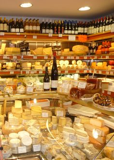 cheese shop on Rue Cler, Paris 7 ar...one of my favorite meal moments was gathering cheese, bread, pâté and wine and sitting in front of the Eiffel Tower.. Magic!