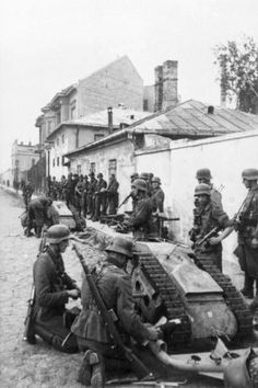 """German soldiers with a """"Goliath"""". The Goliath tracked mine was a remote controlled German-engineered demolition vehicle, also known as the beetle tank to Allies. Employed by the Wehrmacht during World War II this caterpillar-tracked vehicle carried 75–100 kilograms (170–220 lb) of high explosives and was intended to be used for multiple purposes, such as destroying tanks, disrupting dense infantry formations, and demolition of buildings and bridges."""