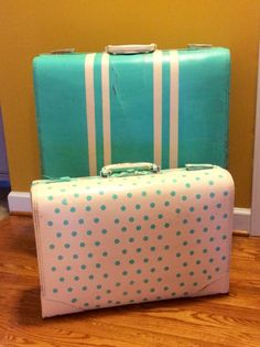 Old painted suitcase on a stand--great for use as an end table ...