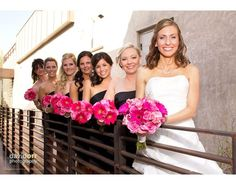 Beautiful hot pink wedding bouquets. Again, the bridesmaids in black.