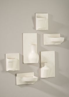 Emerge by Leah K.S. Amick are slip-cast wall pockets inspired by ordinary, familiar objects that have been altered to enhance the beauty of their form.