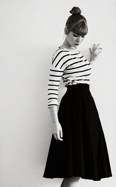 White and black striped shirt, full black midi skirt. Classic.