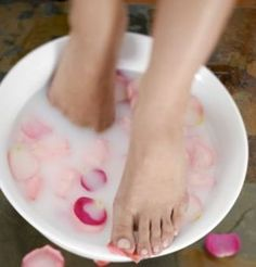 1. Pour 2-4 cups of warm milk (powdered milk works too) into a basin.  2. Soak your feet for 5 minutes.  3. Sprinkle baking soda over feet and gently massage.  4. Soak for 5 more minutes and pat dry.    Pretty feet ready for polish and sandals!