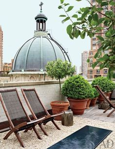 Antiques dealers Angus Wilkie and Len Morgan updated a New York City penthouse apartment that looks onto St. Jean Baptiste Church. The terrace is outfitted with terra-cotta planters.Pin it.