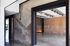 Guthrie Transportation Museum & Welcome Center by De Leon & Primmer Architecture Workshop Brick Architecture, Interior Architecture, English Cottage Interiors, Warehouse Living, Property Buyers, Urban Industrial, Industrial Door, Urban Loft, Built In Storage