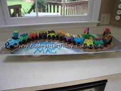 Train Birthday Cake. Great idea with one carriage per guest and lollies in each one make them even more appealing.
