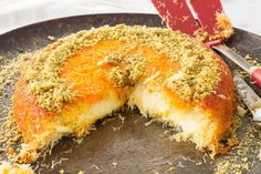Knafeh is a Middle Eastern dessert with a shredded filo dough crust, a sweet cheese filling, topped with a rose water flavored simple syrup. This impressive dessert can be served hot or cold. This recipe is easier than it looks. Lebanese Desserts, Lebanese Recipes, Turkish Recipes, Ethnic Recipes, Palestinian Food, Kunafa Recipe, Middle Eastern Desserts, Impressive Desserts, Sweets