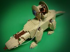 https://flic.kr/p/Reqazo   Fambaa   The Gungan Grand Army uses Fambaas as transports for their impressive shield generators.   Have kept it intact stored in another box and still looks good after all these years. The head rotates around and the legs can be adjusted for poseability. Might build another one if all the pieces are available in the stock.