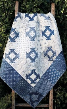 Blue and white traditional churn dash/monkey wrench quilt