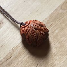 Avocado seed carved by hand with the use of x-acto knife. Finished with a thin layer of clear sealer. Each pattern is unique and doesnt repeat exactly