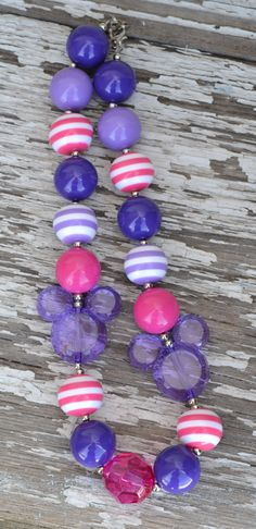 Girly girl glam shocking pink and purple mouse gumball chunky bead necklace. $13.00, via Etsy.