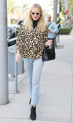 ccdc0e8699 Chloë Sevigny wears an animal-print coat with cropped jeans