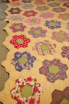 Vintage Grandmother's Flower Garden Quilt Feed sacks Hand Quilted from shebang on Ruby Lane