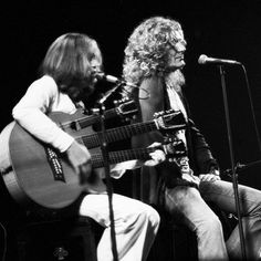 """allaboutjonesy: """" """"John Paul Jones and Robert Plant performing The Battle Of Evermore at Madison Square Garden. June 14th, 1977. """" """""""
