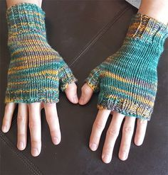 Free knitting pattern for easy Peekaboo Fingerless Mitts - Abi Gregorio designed these easy unisex handwarmers. Great with multi-color yarn!
