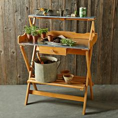http://www.williams-sonoma.com/products/folding-potting-table/