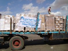 Bridge Foundation cargo offload, Nyala Airport, South Darfur, on way to nearby warehouse 2009