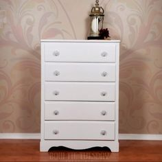 This modern dresser was painted with Dixie Belle chalk paint, Fluff and then the knobs had a mould applied to ad some charm and decorative details. Chalk Paint Dresser, Painted Dressers, Tall Dresser, White Chalk Paint, Modern Dresser, Chalk Paint Furniture, Dresser Drawers, Bedroom Furniture, Painted Furniture For Sale