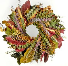 Natural Preserved Spiral Eucalyptus in Amber, Plum and Emerald, with amber, plum & basil salal leaves and wheat.