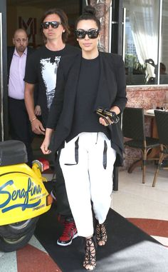 Celebrity Street Style    Picture    Description  For a lunch date in Miami, Kim Kardashian heads out in black-and-white Helmut Lang pants, a black top and blazer.     https://looks.tn/celebrity/street-style/celebrity-street-style-for-a-lunch-date-in-miami-kim-kardashian-heads-out-in-black-and-white-helmut-la/