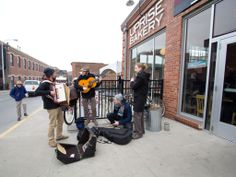 """This is Les Trois Coups performing outside or Ragtag Cinema and Uprise Bakery. """"This charming, hyperkinetic French quartet is back for an encore, mixing street theater and musette-inspired traditional French tunes."""" Photo by Elise Eimer. Film Festival, Fun Things, Filmmaking, Missouri, Columbia, Theater, The Outsiders, Bakery, Cinema"""