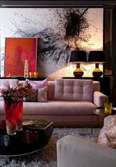 contemporary/ eclectic living room. platform couch. bold colors