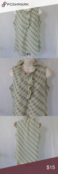 BANANA REPUBLIC Shirt Shell Career Top Size M ITEM DESCRIPTION: Banana Republic Ruffle Front Career Shell Top Sheer Lined Blouse Women Size: M Color: gray yellow white Pattern: Plaid Sleeve Length: sleeveless Closure: Pullover with one button closure Fabric: 100% polyester Made in: China ITEM CONDITION:  Pre-owned...GREAT USED CONDITION!  ITEM MEASUREMENTS (Laying flat): Chest (Armpit to Armpit): 18 ½ in Back Length: 25 in Banana Republic Tops Blouses