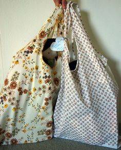 DIY tutorial for reusable shopping bags out of recycled vintage pillow cases.