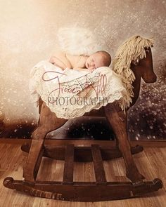 newborn on rocking horse