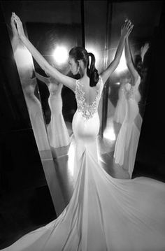 nice mermaid wedding dress love this shot with the mirrors