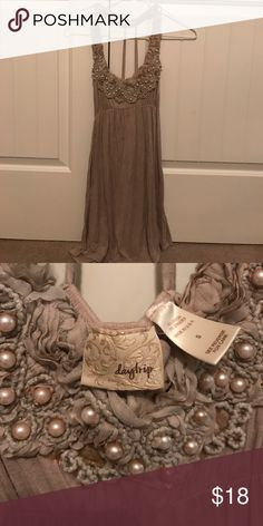 Tan dress from buckle Tan dress, been worn less than 5 times. Pairs great with cowboy boots. Brand is Daytrip, exclusive to Buckle Buckle Dresses