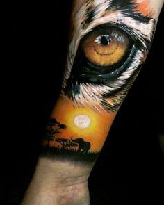 Search inspiration for a Realistic tattoo. Tiger Eyes Tattoo, Lion Tattoo, Arm Tattoo, Sleeve Tattoos, Badass Tattoos, Body Art Tattoos, Skull Tattoos, Kratz Tattoo, Persian Tattoo