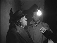 Alphaville, une étrange aventure de Lemmy (1965) Director: Jean-Luc Godard...Henri and Lemmy reflect..(Akim Tamiroff, Eddie Constantine)