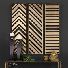 Add sleek, modern style to your walls with the Uttermost Zahara Gold Wall Panels - Set of 3 . This set of three tall metal wall panels are enhanced.