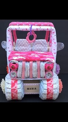 This ADORABLE pink camo diaper jeep is PERFECT for your next baby shower! WANT ALL PINK CAMO???? **********I have recently started making my own recieving blankets which gives ENDLESS possibilities for custom themes!! There are many options at checkout, please be sure to ask me if you have any questions at that time! Also, be sure to leave in the notes to seller section: what your theme/ color scheme is and THE DATE YOU NEED YOUR GIFT TO ARRIVE BY so I can be sure you have it in time! :)…