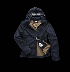 Technically engineered Goggle Bomber in double dyed stretch nylon with water resistant treatment. Fleece lined, this engineered article interprets the CP Company urban style.