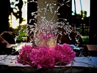Wedding reception centerpiece with bright pink flowers and sparlkly bling