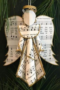 christmas tree ornaments This sheet music angel ornament is included in a round up of handmade paper tree ornaments Paper Christmas Ornaments, Christmas Tree Crafts, Ornament Crafts, Christmas Angels, Christmas Tree Decorations, Handmade Christmas, Ornament Tree, Angel Ornaments, Handmade Ornaments